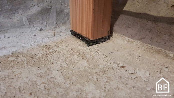 Isoler le bois d'un sol humide