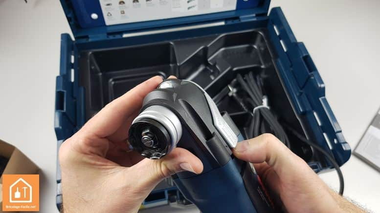 outil multifonctions GOP 40-30 de Bosch Professional - levier pour éjecter l'accessoire