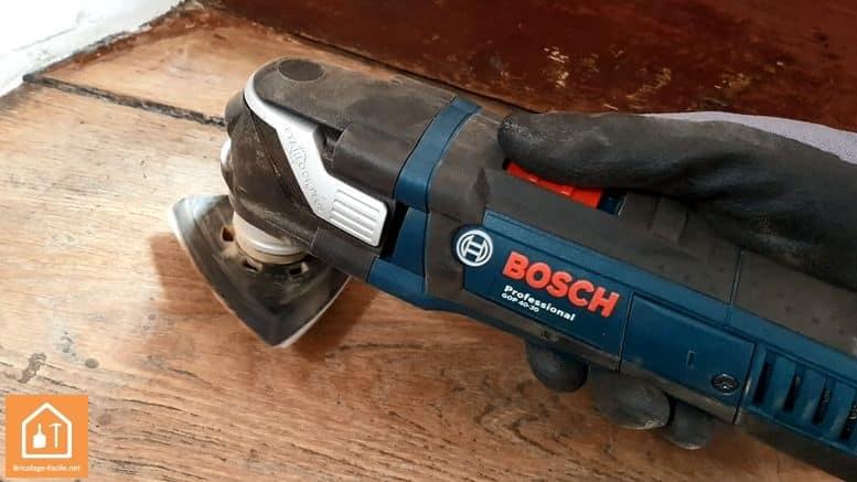 outil multifonctions GOP 40-30 de Bosch Professional - le bouton de démarrage avec gant