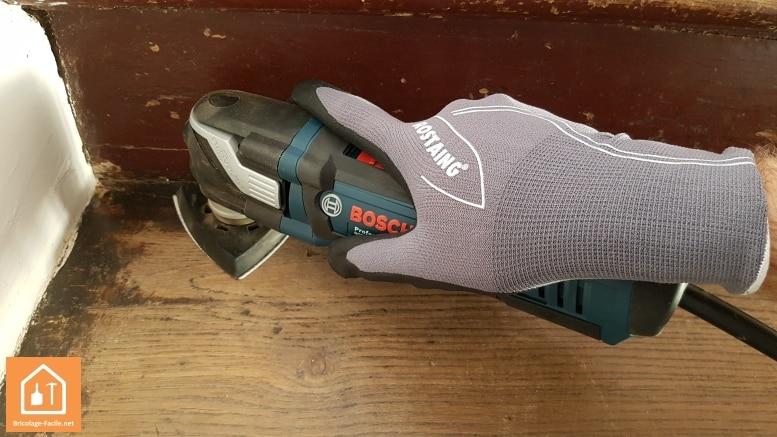 Outil multifonction Bosch Pro avec des gants Rostaing